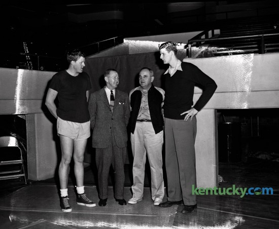 Two of the nation's top basketball programs, head coaches and big men posed for a picture the day before the University of Kentucky played Kansas in Memorial Coliseum in December 1950. From left, are Clyde Lovellette, 6-9 Kansas University center, Kansas  Coach Phog Allen, Kentucky Coach Adolph Rupp and Bill Spivey, 7-foot Kentucky  center. The quartet got together December 15, 1950 at Memorial Coliseum where both the Jayhawks and Wildcats worked out prior to their game December 16, 1950. UK dominated KU and won 68-39. Herald-Leader Archive Photo