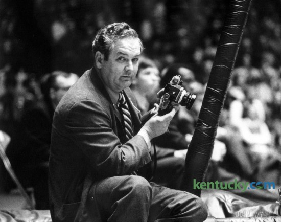 Former Herald-Leader photographer E. Martin Jessee, photographed by Leader chief photographer John C. Wyatt at the University of Kentucky men's basketball game against Miami of Ohio in Memorial Coliseum, December 29, 1969. Jessee was probably the most well-known news photographer in Lexington during his 40 year career. He was a sharp dresser, raced to news scenes in a Cadillac or Lincoln, was very competitive, aggressive when he needed to be, and the main thing was: He always got the shot. He loved breaking news and sports, especially the Kentucky Derby and UK basketball. This blog wishes to recognize Jessee as the Kentukcy News Photographers Association begins its annual meeting today at the Hyatt. Jessee retired in 1984, a year before the association was formed. Photo by John C. Wyatt | Staff