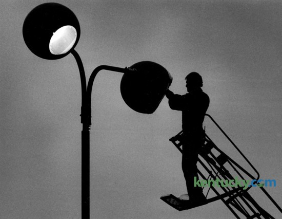 Paul Fletcher worked from a ladder truck to replace a high intensity light bulb on one of the parking lot lights at Hardees Restaurant on the Avenue of Champions on January 20, 1986. Fletcher worked for the Smithers Sign Company. Papa John's Pizza now occupies the space where Hardee's was located. Photo by Charles Bertram | Staff
