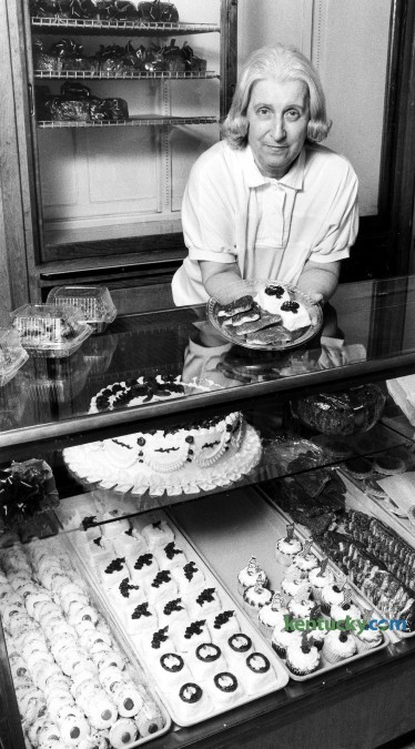 Joyce Higgins, owner of Magee's Bakery with her husband, Ralph, displays some Christmas cookies and pettifores Dec. 6, 1990 that are being baked now for the holidays. Her cases are filled with many other homemade treeats. Phot by Jennifer Podis | staff