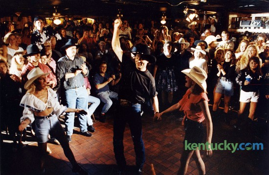 """Lexington country singer John Michael Montgomery during the making of a music video at Austin City Saloon in Woodhill Center in Lexington, June, 3, 1993. Montgomery, who played in the bar for more than five years before he got his big break in Nashville, was filming the video for his song """"Beer and Bones."""" The honky- tonk-style tune was Montgomery's third single from his national album debut, Life's a Dance. """"I'm just enjoying what's happening to me as much as I can,"""" Montgomery said during a break in filming. """"The funniest thing for me is to take it back to the people and bring everything back here to where it started."""" Photo by Frank Anderson 