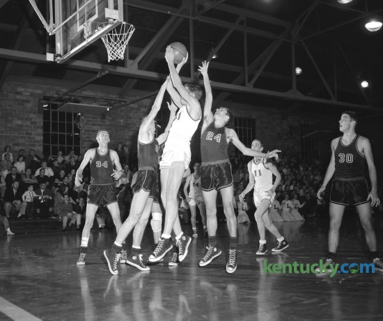 Lafayette High School's Jeff Mullins leaped off the floor to fire a shot as Hartford's Chip Combs, tried to block it on January 24,1959. The Generals, playing on their home court won 85-65. Senior guard Jon Speaks and junior forward Jeff Mullins paced the Generals with 24 points apiece. Published January 25, 1959. Lafayette plays Trinity tonight in Louisville. Herald-Leader Archive Photo