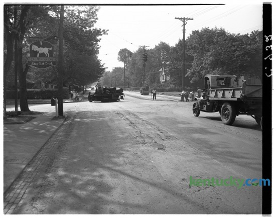Resurfacing of Richmond Road, at the intersection of Ashland Avenue, Aug. 26, 1948. The resurfacing was one of the final parts of a year-long project to widen Richmond Road from two lanes to four, to an area just past Idle Hour Country Club, but before the Lexington reservoir. Over the years, more restaurants have been at this intersection, 735 East Main Street, than perhaps any other location in town. At left is the sign for the first restaurant at this address, the Stirrup Cup, whcih opened in 1938. It closed in the 1960s but reopened in 1980, only to close again in 1982. Today it is Coles 735 Main restaurant. Herald-Leader archive photo.