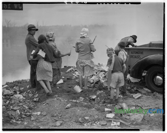 In May of 1940 The Sunday Herald-Leader carried a story about the daily scavengers who desended on Lexington's city dump, on Old Frankfort Pike, hoping to find anything of value that they could sell or use themselves. This photo was an outtake from that story and shows a group going through a freshly unloaded pile of trash. The article noted that the scavengers lived in shanties which dotted Manchester, Driscoll, deRoode, Perry, Jane and adjoining streets. They tended to arrive about mid-afternoon each day and usually left by dark. If an individual earned a dollar a week they considered themselves lucky. The story ran May 19, 1940. Herald-Leader Archive Photo