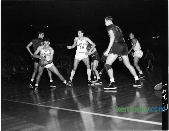 University of Kentucky sophomore Cliff Hagan grabbed a lose ball during the No.1-ranked Cats' 88-41 win over Georgia, Feb. 23, 1951 at Memorial Coliseum in Lexington. This was UK's first season playing in Memorial Coliseum, which was completed in 1950 at a cost of $3.9 million. UK's Lou Tsioropoulos (16), is at center. UK would finish the season 32-2, winning it's 14th SEC regular season title and later it's third NCAA championship with a 68-58 win over defeated Kansas State. Herald-Leader Archive Photo