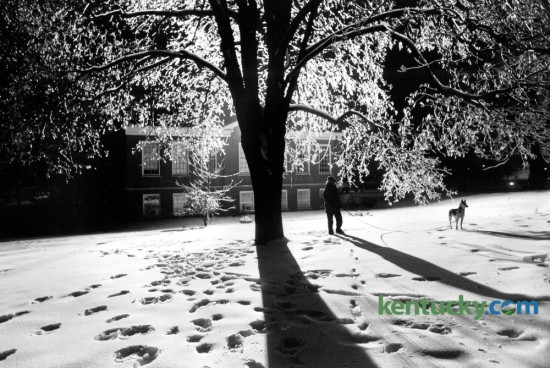 Transylvania graduate Susan Montgomery and her dog Kodi walked across the ice covered Transy campus late one evening in January 1979 after an ice storm had moved through Lexington. Photo by Ron Garrison | Staff