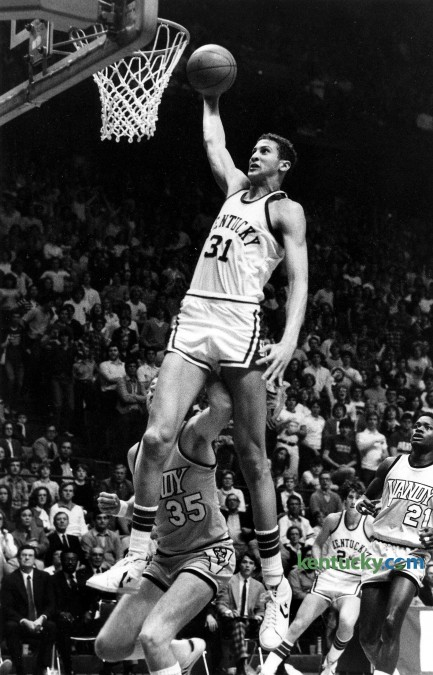 Kentucky center Sam Bowie slammed home two of his game-high 19 points during a 80-48 Wildcat win over Vanderbilt, Feb. 21, 1981 at Rupp Arena in Lexington. The sophmore also pulled down 15 rebounds in the win for the 10th ranked Wildcats, who were only up by two at the half, 26-23. UK wen on to finish the season 22-6, but lost their last two games of the year - one in the SEC tournament and the other in their opening NCAA Tournament game. Bowie had to sit out the follwing two seasons because of stress fracture in his left tibia. He returned for the 1983-84 season and finished his three-year Wildcat career wirh 1,285 points, currently 30th on UK's all-time career points list. Photo by Charles Bertram | staff