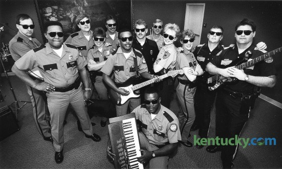 In 1993, Lexington police officer Debbie Wagner, fourth from the left, organized the DARE 911 Band, which used rock music to spread an anti-drug message to area schools. The group, photographed on Feb. 9, 1993, were made up of members of The Lexington Police, Fayette Co. Sheriff's Dept., University of Kentucky Police, and the Horse Park Police. Wagner, a 38-year veteran of the force known for community outreach, retired from the Lexington police force in January, 2016. Photo by Charles Bertram   staff