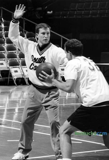 Brian Lane, then an assistant basketball coach at South Carolina, guarded player Brad Hinson during practice before the SEC Tournament, March 10, 1993 at Rupp Arena in Lexington. Lane has been the coach at Transylvania University in Lexington since 2001. The Lexington native was an assistant at Transey under his college coach and father Don Lane during the 1990-91 season. For the next 10 years Lane was an assistant at five different Division I schools, including this one year at South Carolina. While coaching at Transey, he is the only coach in league history to win HCAC Coach of the Year four times and is the fastest coach to 200 wins in schooll history. Lane has led the Pioneers to 20 or more wins four times and qualified for the NCAA National Tournament five times. Photo by Frank Anderson | staff