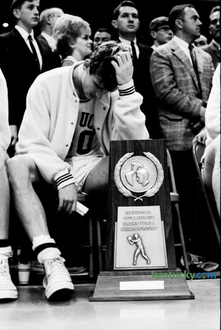 Kentucky guard Tom Kron slumped in his chair in front of the runner-up trophy during presentations following Kentucky's loss to Texas Western in the NCAA championship game on March 19, 1966 in College Park, Md. Photo by Jeff Watkins | Staff