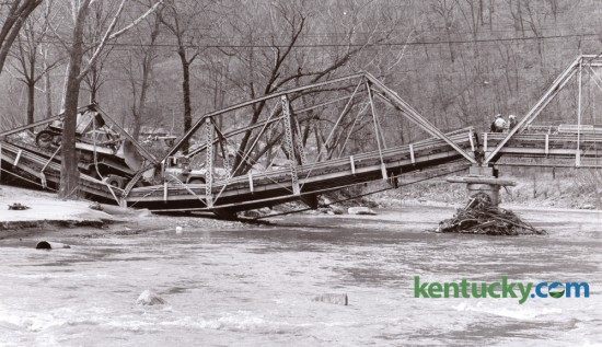 A span of the Brookside bridge over Clover Fork in Harlan County collapsed on March 13, 1978 when an Eastover Mining Company truck pulling a trailer with a bulldozer attempted to cross the bridge. The 60-year-old trestle bridge was on Ky. 38, a narrow twisting blacktop road that was a major highway for the mining and logging areas east of Harlan. Photo by Ron Garrison | Staff