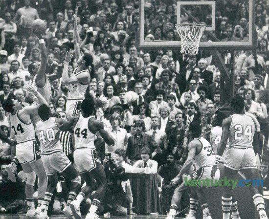 Kentucky's Sam Bowie rose to block the game's final shot by LSU's Howard Carter as the ninth-ranked Wildcats knocked off the No. 2 Tigers on March 1, 1981, in Rupp Arena. The UK win prevented LSU from completing an undefeated SEC season. Bowie finished the game with 11 points, nine rebounds and four blocks. Photo by David Perry   Staff