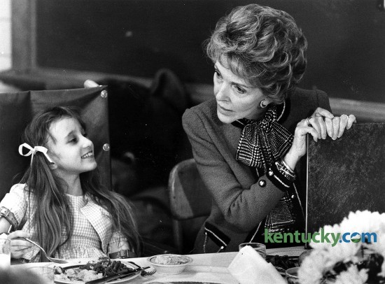 """First lady Nancy Reagan had lunch with Tracy, 8, and other young patients at Shriners Hospital on Nov. 2, 1984, during a campaign swing through Southern states three days before the presidential election. Ronald Reagan, her husband, would be elected in a landslide, carrying 49 of the 50 states and narrowly losing Minnesota, the home state of Democratic challenger Walter Mondale. Nancy Reagan, who died Sunday at age 94, was known during her husband's presidency for her """"Just say no"""" drug-abuse prevention campaign aimed at youngsters. At Shriners, Dr. David B. Stevens, the chief of staff at Shriners and a former student of Nancy Reagan's stepfather, renowned neurosurgeon Loyal Davis, gave her a tour. It took about an hour, and she visited each of the 34 patients at the 50-bed hospital. During a Herald-Leader interview that day, Reagan spoke positively of Geraldine Ferraro, Mondale's running mate and the nation's first female vice presidential candidate of a major party. She called Ferraro's candidacy """"a natural progression"""" for women, and said she didn't seen any reason why a woman couldn't be president one day. Photo by David Perry   Staff"""