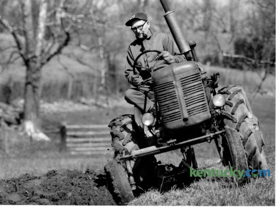 Forrest McGinnis, 72, took advantage of warmer weather on March 4, 1987 to start plowing for his tobacco crop on his 70 acre farm in Mercer County. He said he planned to grow approximately 2000 pounds of tobacco that year on his farm that was located on US 68 between Harrodsburg and Perryville. Photo by Charles Bertram | Staff