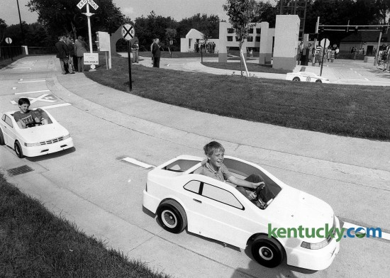 The opening of Safety City, Lexington's make-believe city that teaches children about automobile and pedestrian safety, May 23, 1990. The community project includes a network of two-lane streets that is realistic in detail, with curbs, sidewalks and pedestrian crossings. More than 2,000 children from Central Kentucky visit Safety City each school year. The city is a partnership between Eastern Kentucky University and the Lexington Police Department. A new fleet of electric cars was recently purchased with the help of a $49,000 donation from Toyota, replaced an aging fleet that had dated back to Safety City's opening in 1990. Photo by Stephen Castleberry | staff