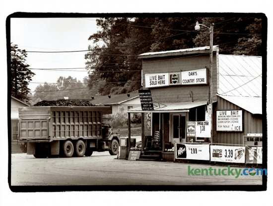 A coal truck moved past Dan's Country Store in Chavies, Ky. in June 1993. Store owner Dan Farler said his store, which featured a mini museum of coal mining equipment, was a popular lunch spot for coal truck drivers. The photo ran with with story about a day trip to Perry County. Photo by Charles Bertram | Staff