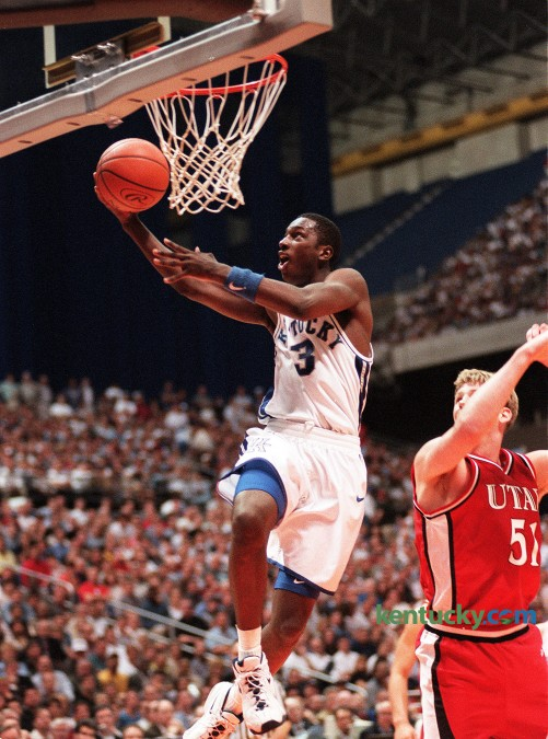 Kencuyk's Allen Edwards goes up for a layup against Utah's Micheael Doleac during the Cats' 78-69 win in the NCAA Championship game, March 30, 1998 at the Alamodome in San Antonio, Texas. Edwards, a senior and one of three team captains, scored four points in the win that gave the Cats their seventh national titile. Edwards was promoted to head coach at Wyoming, March 21, 2016. Photo by Janet Worne | staff