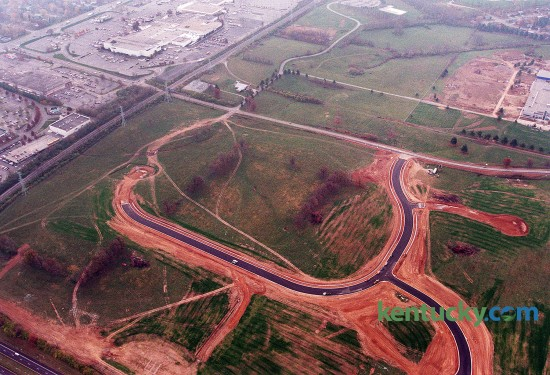Aerial view of development between Reynolds Road (running left to right across the middle) and New Circle (lower left corner) in Lexington, Nov. 19, 1998. The road being built would become Ruccio Way and a Meijer supermarket would open on the site in 2000. Meijer paid $10.7 million for land on the former RJ Reynolds Tobacco property, which would become their second Lexington location. Reynolds Road was widened soon after the store opened. In the upper left corner is Fayette Mall. In the upper right is construction of Lexington Christian Academy. The high school opened two months later in January of 1999. Photo by David Stephenson | staff