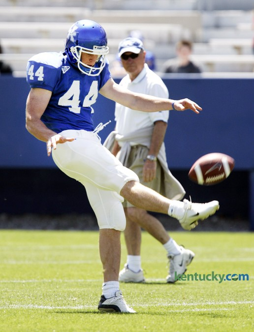 University of Kentucky punter Tim Masthay got off a clear punt under the watchful eye of head coach Rich Brooks during the spring Blue-White football game April 22, 2006 at Commonwealth Stadium. Later that year, Brooks guided UK to its first bowl game in seaven seasons. The Cats beat Clenson in the Music City Bowl, finishing the season at 8-5, 4-4 in the SEC. Brooks coached the Cats from 2003-09, compiling a 39-47 record. Masthay, a sophmore-to-be at the time of this picture, was a four-year starting punter for the Wildcats. He was a 1st team All-SEC selection his senior year in 2008 and is currently the punter for the NFL's Green Bay Packers. Photo by David Stephenson | Staff