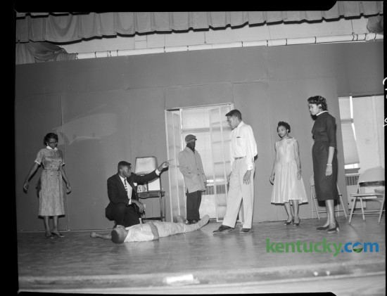 Senior play at Douglass High School. The cast includes, from left, Mary Laine, Robert Shy, George Bell, Donald Demus, Andrew Fisher, Joan Miller and Anita Bledsoe. Other characters are portrayed by Helen Caise, Waller Edwards, Douglas Holland and Gladys Hayes. Published in the Herald-Leader April 14, 1957. Herald-Leader Archive Photo
