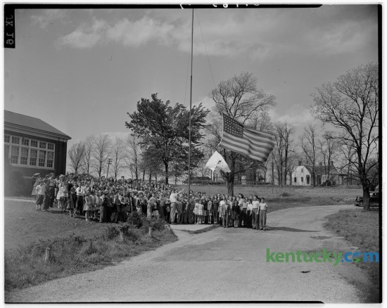 Students and teachers lined up for a photo during their schools-at-war flag raising at Linlee school April 18, 1945.  The flag was presented by the Linlee PTA because 90 percent of student body made monthly purchases of war stamps. The school was first in the county to reach the 90 percent mark. Published in the Lexington Herald April 19, 1945. Herald-Leader Archive Photo