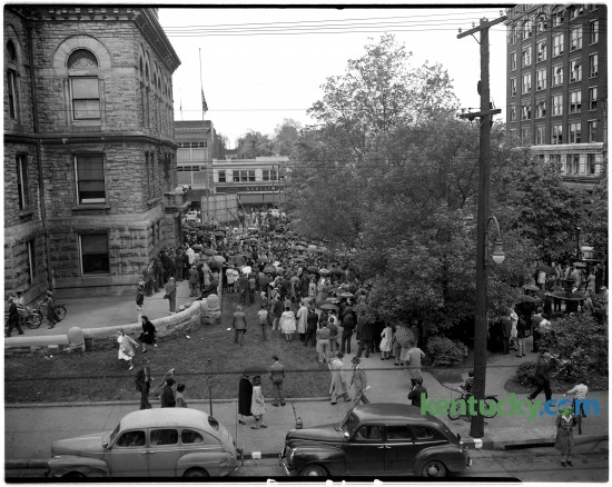 """An estimated 3,000 people attended a community memorial service April 14, 1945 outside the Fayette County Courthouse in honor of President Franklin Delano Roosevelt. FDR as he more commonly know, died while in office two days earlier from a stroke. Harry Truman then became the 31st President of the United States. Religious leaders and politicians spoke during the service before a crowd that stood motionless and mute, even during a downpoor of rain which forced the ceremony to move inside the courthouse from Cheepside Park. The ceremony ended with mourners singing """"God Bless America"""". Published in the Sunday Herald-Leader April 15, 1945. Herald-Leader archive photo"""