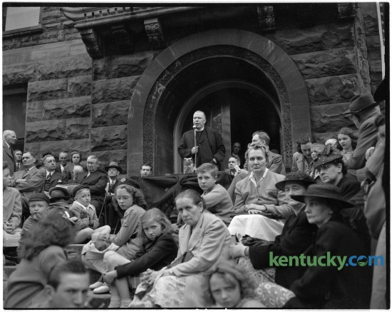 President Franklin D. Roosevelt mourners listened to Rev. Father George O'Bryan during memorial services, April 14, 1945 at Cheepside. Seated at left is Rabbi Julian F. Fleg, and at right, Mayor R. Mack Oldham. Published in the Lexington Herald-Leader April 15, 1945. Herald-Leader Archive Photo