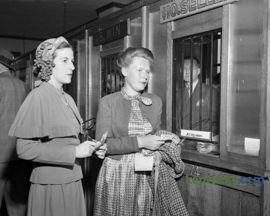 Mrs. Samuel Walton Jr. and Mrs. Wickliffe Johnstone prepared to place their bets during the Keeneland Spring meet in April of 1949.  Published in the Lexington Leader April 19, 1949. The Spring 2016 meet continues at Keeneland through Friday April 29. Herald-Leader Archive Photo