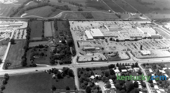 An aerial view of Fayette Mall, May 13, 1985. Nicholasville Road runs from left to right across the bottom. The left side of the mall at this time was a Sears store, one of the anchors of the shopping center. In May 1993, the mall expaned, adding nearly two dozen merchants in a new south wing, in the area to the left of Sears in the picture. The expansion made it the Kentucky's largest mall. In 2006, The Plaza at Fayette Mall, a shopping center with a Cinemark Theatres and restaurants, opened in the area on the far left side of the photo. Across the top of the picture is Shillito Park. The park's pool, whcih opened in the summer of 1988, is located just to the left of the curve in the road. Photo by Nick Nickerson | staff