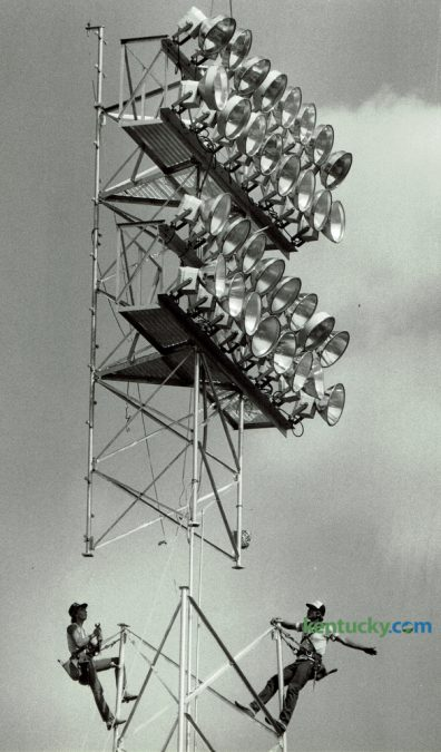 Workers Shane Sowards, left, and Mike Powell, both from Ft. Wayne, Ind., prepared to attach a bank of lights to one of six newly installed lighting towers at the University of Kentucky's baseball field at the Shively Sports Complex on September 14, 1987. The lights, a $200,000 project were in place in time for the team's opening game September 19. The six new towers contained a total of 180 lights. Photo by Frank Anderson | Staff