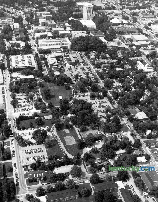 Aerial photo of the area of the University of Kentucky campus showing the site of the new library on August 26, 1993. What would be named the W.T. Young library was built in the lower center area of the photo and bounded by Hilltop Ave, at left, and Woodland Ave, across the bottom of the photo. Construction begain in 1994 and the library was dedicated in 1998. Photo by Ron Garrison | Staff