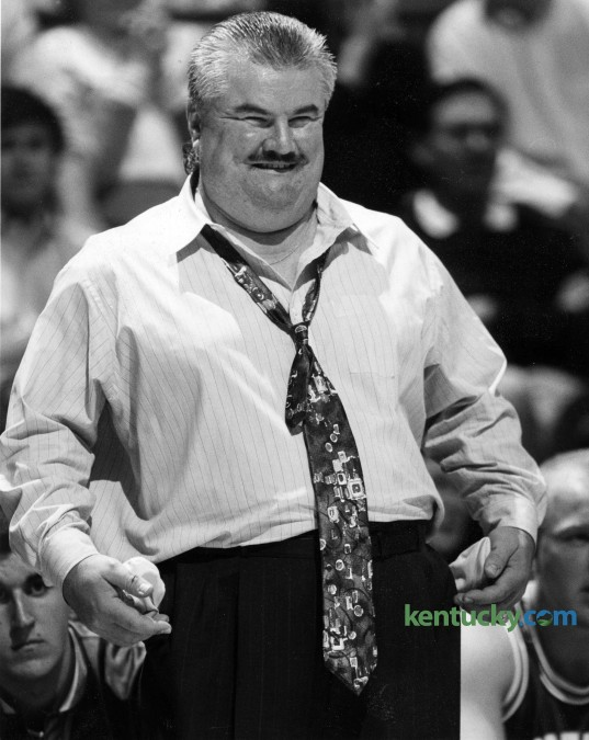 """Morehead State basketball coach Dick Fick reacts to an officials call during the Eagle's 97-61 loss to Kentucky at Rupp Arena Dec. 17, 1993. The flamboyant coach led the Eagles for six rollicking years (1991-97) and compiled a 64-101 record. He was known so well known for his sideline antics that the late Jim Valvano of ESPN handed out the """"Dick Fick Award,"""" which went weekly to the coach who showed the most sideline animation. Once, in a game in Cincinnati, Fick held up a three-point sign to the UC student body every time Morehead made a three-pointer. His most famous moment came in 1992 in a game against Kentucky in Rupp Arena. MSU was victimized by an over-the-back call. In response, Fick collapsed flat on his back, his arms elevated straight up in disgust. But Fick could be every bit as clever as he was ebullient. One summer, he picked up a newspaper and saw that University of Cincinnati center Art Long had been arrested for punching a police horse. He was immediately on the phone to Bearcats Coach Bob Huggins. """"Bob, I can help you,"""" Fick said. """"I know there is no way Art Long punched that horse."""" Huggins: """"How?"""" Fick: """"He's still in the lane from when we played you last year."""" In 1997, Morehead refused to extend Fick's contract and in 1999, he publicly admitted that he was an alcoholic after he was in and out of alcohol treatment programs. He wound up back in his hometown of Joliet, Ill., part-time assistant coaching at St. Francis of Illinois, a NAIA school. On April 28, 2003, the 50-year-old was found dead in the Joliet apartment where he lived by himself. Photo by Frank Anderson 