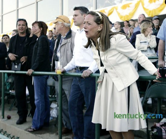 Fans react to watching Barbaro struggle to load onto the ambulance after he broke his leg after the start of the Preakness Stakes at Pimlico Race Course in Baltimore, Md., on Saturday, May 20, 2006. David Stephenson/Staff