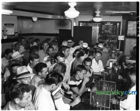 """For a couple of hours on June 14, 1949, Fisher's Bar, 105 North Limestone Street, was jammed packed with patrons. The reason? Nickel been and whiskey and five-cent sandwiches. Nearly 600 male customers were served from 2-4 p.m. and the scene in the picture shows only about half of the crowd. Popular brand blended and bonded whiskey's and beer and a variety of sandwiches sold for five cents. George West, the bar's owner said, """"The drinks and eats are on the house - almost."""" The bar is not the location of Sam's Hot Dog Stand. Published in the Lexington Herald June 15, 1949. Herald-Leader Archive Photo    Crowd in Fischer's (cq) Lunch (cq) during five-cent sale. George West is operator of bar. Published in the Lexington Herald June 15, 1949. Herald-Leader Archive Photo"""