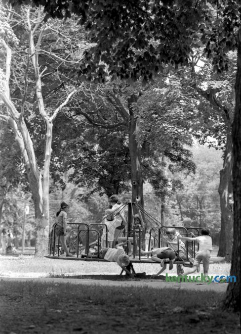 The merry-go-round at Woodland Park in Lexington served as a good place for children to enjoy the Memorial Day holiday, May 29, 1972. Published in the Lexington Leader, May 30, 1972. Herald-Leader archive photo
