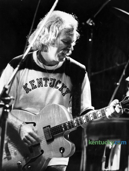 """Musician Jimmy Buffett performs at the University of Kentucky's Memorial Coliseum, Sept. 30, 1977. The musician is known for his """"island escapism"""" lifestyle tune and he has a devoted fan base known as """"Parrotheads."""" Together with his Coral Reefer Band, Buffett played before 8,000 for a two-hour set at Memorial. Tickets for the show were $6 and $5. During the show Buffett recalled the first time he played UK. It was at the student center grill and he said he was a young entertainer trying to make ends meet on the """"coffeehouse circuit"""". At the same time Buffett played on the UK campus, country singer Charley Pride performed at Rupp Arena. Photo by Mike Kearney 
