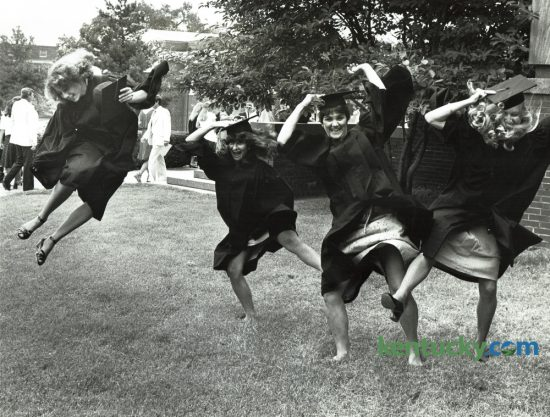 Transylvania University graduating seniors, from left, Susan Amato of Lexington, Michelle Jackson of Maysville, Amy Black of Pikeville and Kim Siebers of Fulton, N.Y. jumped for joy in anticipation of receiving their degrees May 31, 1981 at Transylvania's commencement. Poet Wendell Berry was principal speaker at the ceremony in Haggin Auditorium, at which 156 students received diplomas. This morning at 9am Transylvania University will award 270 degrees to the class of 2016. Photo by David Perry | Staff