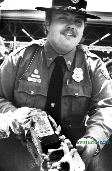 Officer Paul Bullock confiscated whiskey in loaves of bread. Guards at the gates tried to take any alcohol but of course, much made its way in. One Louisville man poured vodka into plastic zip-lock bags, then hid them beneath a salad in a Tupperware bowl. He made it successfully past the gate. Photo by Christy Porter | staff