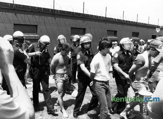 Louisville police officers detain some Kentucky Derby infield patrons May 7, 1983 at Churchill Downs. Many were taken to a holding cell located nearby. Photo by Charles Bertram | staff