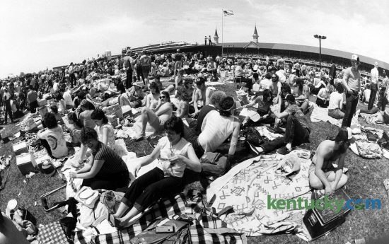 The crowd in the infield on Derby Day, May 7, 1983 at Churchill Downs. The crowd of 85,000 spread out across the 144 acres of the infield was described by Kentucky Derby regulars as one of the raunchiest in memory. Across the grounds, women found themselves as instant celebrities as they lifted their shirts to the cheers of many around. Photo by Charles Bertram | staff