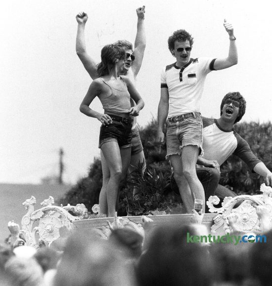 Infield revelers climbed up on a huge white garden urn and encouraged a woman to strip. Across the grounds, women found themselves as instant celebrities as they lifted their shirts to the cheers of many around. Photo by Charles Bertram | staff