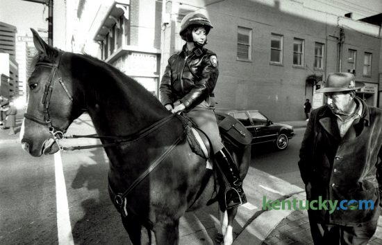 Officer Karen Love, on Red, talked with Harlan McQuinn in downtown Lexington on December 29, 1986. Love, then 30, went on the job that week as the first female member of the Lexington Mounted Patrol. You can see a story, photos and video on Lexington Police Deparment's Mounted Unit in today's Herald-Leader and on Kentucky.com. Photo by David Perry   Staff