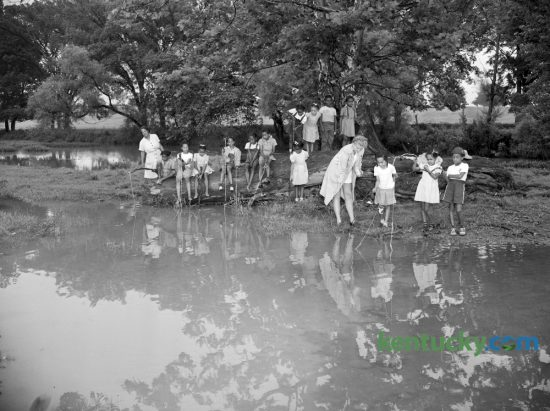 These Brownie Scouts vacationing at the Girl Scouts Day camp on Mt. Brilliant Farm in July 1947 were part of a complement of 35 girls who have been attending an outdoor health and athletic program there for the past two weeks. Guided by nine counselors, the Scouts' program included fishing, hiking, cooking, handicrafts and folk dancing. Counselors in the picture are Mary Caldwell Taylor, far left, and Olive Jean Heckler. Herald-Leader Archive Photo