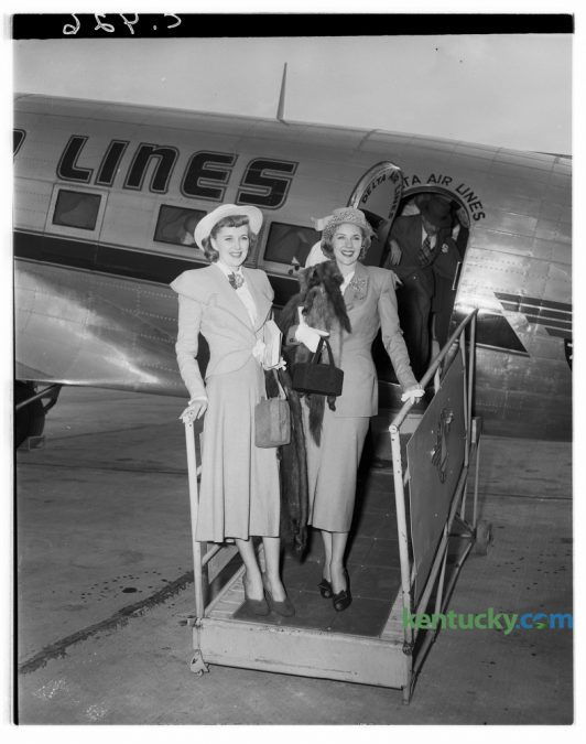 """Marie """"The Body"""" McDonald, right,  posed with Mrs. Danny Bordett, upon her arrival in Lexington's Blue Grass Field in April 1948. She was enroute to visit relatives in Burgin, Ky., her home town.  McDonald was born Cora Marie Frye,  and after her parents divorce she moved with her mother and stepfather to Yonkers, New York. At the age of 15, she began competing in numerous beauty pageants and was named """"The Queen of Coney Island"""", """"Miss Yonkers"""" and """"Miss Loew's Paradise"""". At the age of 15, she dropped out of school and began modeling. In 1939, McDonald was named """"Miss New York State"""". She landed a showgirl role on Broadway at age 17 and shortly thereafter moved to Hollywood. She appeared in films and on stage until her death in 1965. Published in the Lexington Leader April 27, 1948. Herald-Leader Archive Photo"""