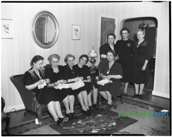 Photograph taken sometime in 1946 of a sewing circle which had met weekly for 18 years.  Mrs. Henry W. Gentry, Mrs. John H. Bowman, Mrs. George W. Tudor, Mrs. William P. Turner, and Mrs. George R. Hukle.  Standing, Mrs. Mae C. Rice, Mrs. Andrew Hamon, hostess, and Mrs. Margaret Marquis. Herald-Leader Archive Photo