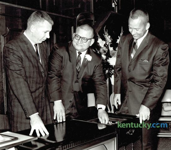 Edward Cruze, chairman of Southland Christian Church board, left, Rev. Wayne B. Smith and Rev. Jack Ballard, guest speaker from Decatur, Ga., looked over a surprise gift, a combination television, radio and record-player set, during dedication ceremonies for the church's new location on Hill 'n Dale Road, on November 8, 1964. Rev. Wayne Smith, 87, who for four decades led what is now Lexington's largest congregation died peacefully Tuesday night. Herald-Leader Archive Photo