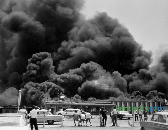 Fire destroyed the Joyland Casino and other buildings at what had been Joyland Park on Lexington's north side in June of 1965. The park closed in 1964 and the casino was not rebuilt. Joyland Casino was not a place for gambling, which was illegal, but a gathering place for social events and dances. Mary Todd Elementary School and Joyland Bowling alley were built on the site of the park. Published in the Lexington Leader June 21, 1965 in Lexington. Photo by John C. Wyatt