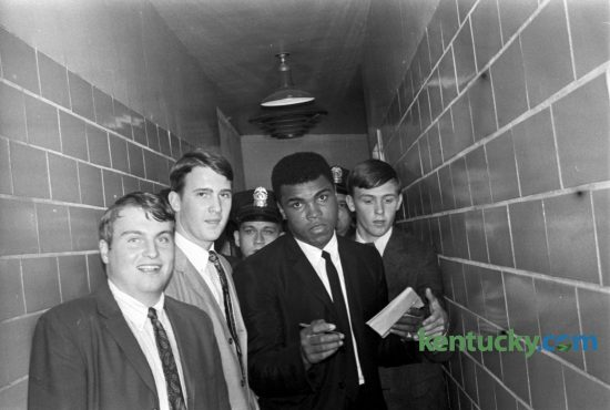 "Heavyweight champion Muhammad Ali shown as he was leaving Freedom Hall in Louisville after a 6-round charity exhibition fight with Doug Jones October 27, 1966. UPI called it ""humiliating"" for Jones, who had hoped a good showing might get him a rematch. In 1963 Jones  lost a 10-round decision to the young Cassius Clay in a sold-out Madison Square Garden. Published in the Lexington Herald October 30, 1966. Herald-Leader Archive Photo"