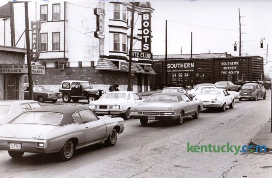 Traffic on South Broadway was frequently delayed by this railroad crossing, as seen in this 1978 photo. After years of study and planning an underpass was built to alleviate the traffic congestion and opened in the fall of 1987. At left next to the tracks is Boots Bar, a popular night club. At extreme left is Coomer's another popular night club. Direct access to both businesses was cut off by the new underpass and this portion of South Broadway became a dead end at the tracks. Photo by Christy Porter | Staff