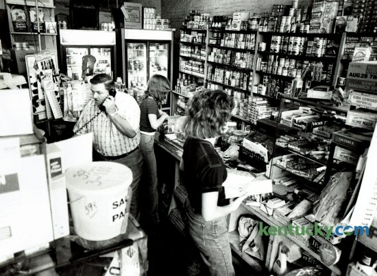 Joe Ballard, owner of Ballard's Market,  took a phone order in his store on Jefferson Street in June of 1978. He was one of the few small store owners who still offered home delivery in the neighborhood. The building no houses the Gray Goose Restaurant.  Photo by Christy Porter | Staff